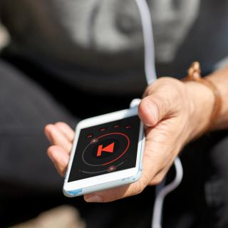 Man listens to music on a phone