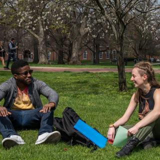 Students relaxing on the oval