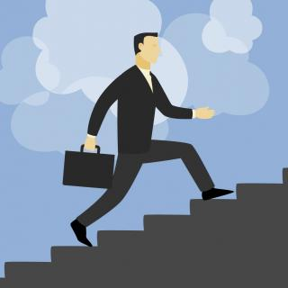 businessman climbing up stairs