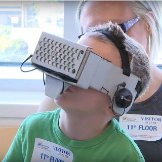 child at the hospital with a virtual reality helmet on