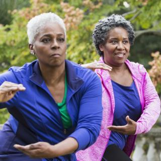Ladies practicing Tai Chi to alleviate pain, The Ohio State University