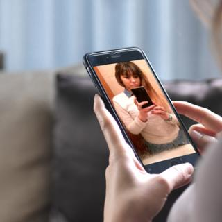 Woman looking at selfie on mobile device