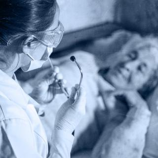 Image of health-care worker caring for elderly patient