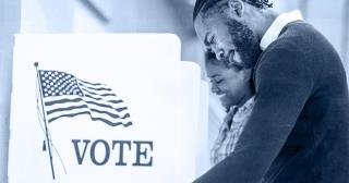 Image of man at voting booth