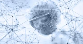 Image of nurse in PPE treating patient with connecting nodes overlaid