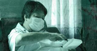 Man in mask administers antibody test